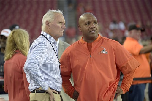 Hue Jackson was dressed in orange from neck to knee. With pullover and shorts the hue of a construction barrel