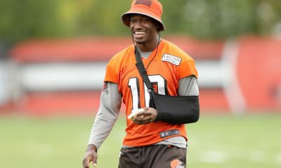 BEREA -- Robert Griffin III stood in the middle of the practice field Wednesday but had traded an orange helmet for a black sling. He walked rather than sprinted between drills. He left the throwing to Josh McCown and Cody Kessler.