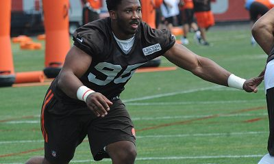 BEREA -- Cam Johnson and Tyrone Holmes got more time with the starters at right defensive end than Myles Garrett did Tuesday during the first practice of minicamp.